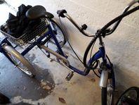 Monark 3 hjulig elcykel mot A-traktor